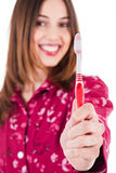 Young women showing the toothbrush Royalty Free Stock Images