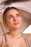 Young women with a silver umbrella Royalty Free Stock Images