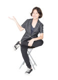 Young women sit on chair over white Stock Photos