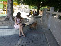 Young women sit on the sidewalk for a rest Royalty Free Stock Images
