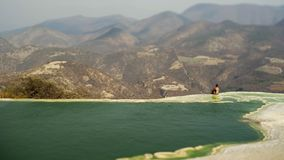 Mexico Hierve el Agua;. Young women siting on the beautiful view in mauntain in mineral spring pool, Mexico Hierve el Agua stock video footage