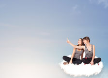 Young women sitting on cloud with copy space royalty free stock images