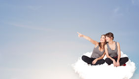 Young women sitting on cloud with copy space Stock Images