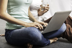 Young women sitting and using laptop Royalty Free Stock Photography