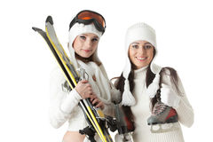Young women with skates and skis. Royalty Free Stock Photos