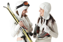 Young women with skates and skis. Royalty Free Stock Image