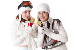 Young women with skates, skis and mulled wine. Stock Image