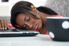 Young women sleeping with her head on a laptop Stock Images