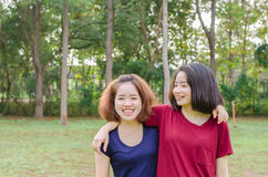 Young women smile after excercise. Two young Asian women smile after excercise together Stock Images