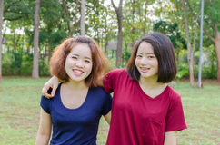 Young women smile after excercise. Two young Asian women smile after excercise together Stock Image