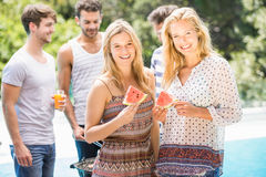 Young women smiling and having a slice of water melon Royalty Free Stock Photos