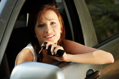 Young women smiling and sitting in the car. Royalty Free Stock Photo