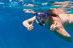 Young women at snorkeling in the Andaman Sea. Young woman at snorkeling in the Andaman Sea of Thailand Royalty Free Stock Image