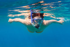 Young women snorkeling in the blue sea royalty free stock image