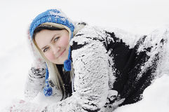Young women on snow. Young woman on snow in blue hat Stock Image