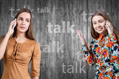 Young women speaking on phone Royalty Free Stock Photography