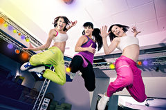 Aerobics girls. Young women in sport dress at an aerobic and zumba exercise Stock Photo