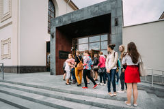Young women stand in line at the Concert Hall Royalty Free Stock Images