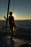 Young women standing on the edge of the sailboat Stock Photography