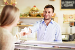 At the counter Royalty Free Stock Photo