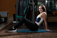 Young Women Stretches In Fitness Club Royalty Free Stock Image