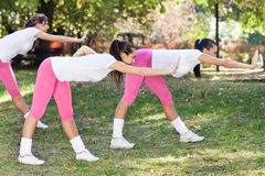 Young women stretching Royalty Free Stock Images
