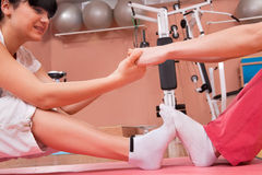Young women stretching in fitness club Stock Photography