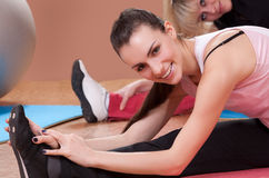 Young women stretching in fitness club Royalty Free Stock Images
