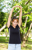 Young women stretching her arm Stock Images