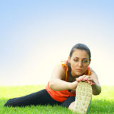 Young women stretching outdoors Stock Photography
