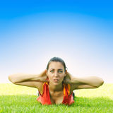 Young women stretching outdoors Royalty Free Stock Photo