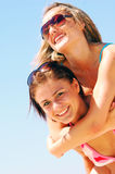 Young women on the summer beach royalty free stock photography