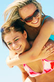Young women on the summer beach Royalty Free Stock Photos