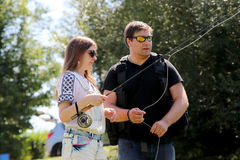 Young man and a woman with fishing rod on a river in Germany Royalty Free Stock Images