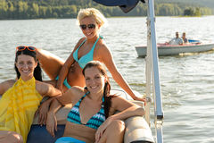 Young women sunbathing on boat Royalty Free Stock Image