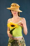 Young women with sunflowers Royalty Free Stock Image
