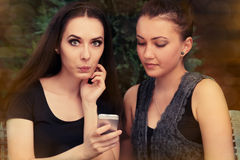 Young Women Surprised by Text Message Royalty Free Stock Image