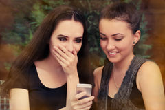 Young Women Surprised by Text Message Royalty Free Stock Photography