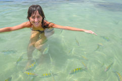 Young Women swimming with tropical Fish. Bahia, Boipeba Brazil. Stock Photography