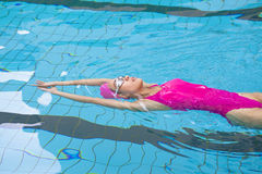 Young women is swimming royalty free stock photography