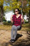 Young women on a swing at fall stock photos