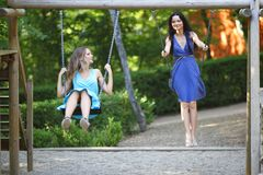 Young women swinging Royalty Free Stock Images