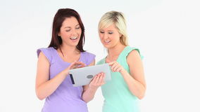 Young women with a tablet Royalty Free Stock Photos