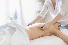 Young woman take back treatment at health spa Royalty Free Stock Photography