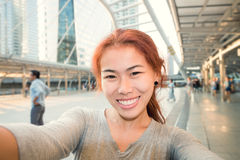 Young women take selfie photo in city Stock Photo