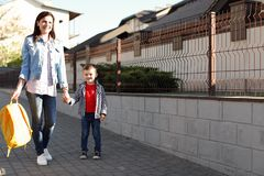 Young woman taking her little chil. Young women taking her little child to school royalty free stock photography