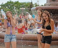 Young women taking part in Water Wars flashmob in Volgograd Royalty Free Stock Photos