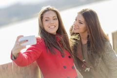 Young women taking photo with mobile phone Stock Photo