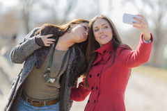 Young women taking photo with mobile phone Stock Photography