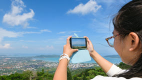 Young women taking photograph with mobile phones Stock Photo